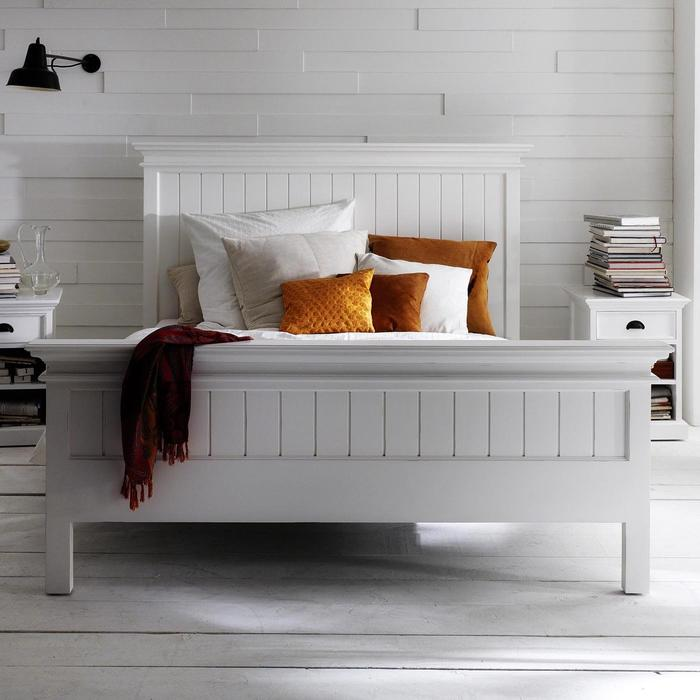 A white halifax wooden bed frame in a white room